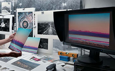 Photography office with EIZO monitor and prints